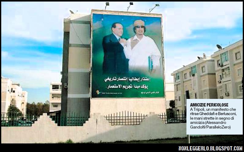 Manifesti per le vie di Tripoli