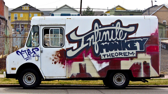 The Infinite Monkey Theorem truck parked north of downtown Denver in front of some colorful houses.