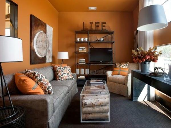 decorada con paredes en naranja terracota y muebles grises el naranja