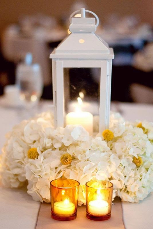 http://boards.weddingbee.com/topic/lantern-and-flower-centerpiece-pictures/#axzz2aS5WwcnW
