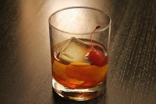 Old fashioned with bacon-infused bourbon and maple