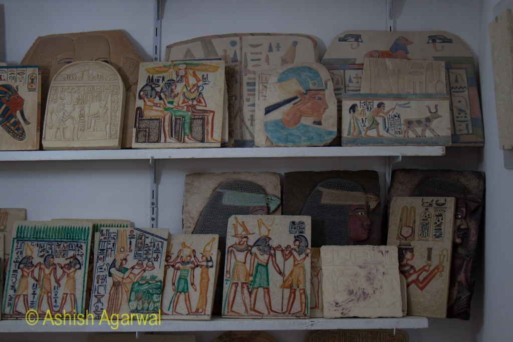 Paintings or etchings on a hard surface at a small exhibit near the Valley of the Kings