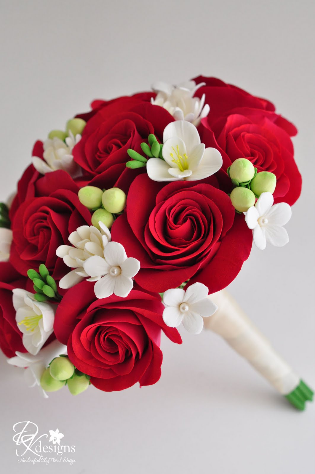 Red Roses Freesia Stephanotis Tuberose And Hipericum Berry