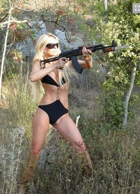 Bikini blonde with a gun