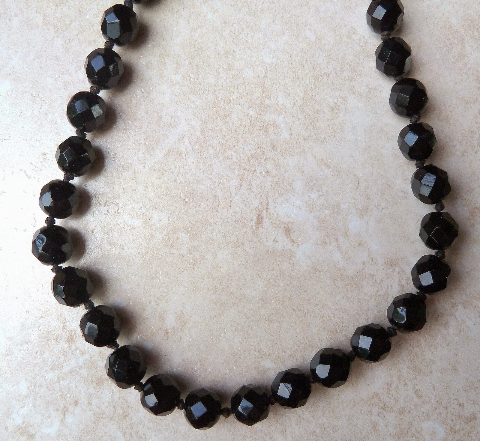 http://www.kcavintagegems.uk/vintage-hand-knotted-french-jet-necklace-375-p.asp