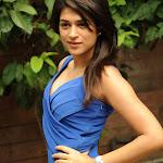 Shraddha Das in Blue Dress @ Mugguru Pressmeet Pics