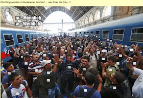 """Ein Screenshot aus einem Video über Asylanten in einem Budapester Bahnhof: Alles junge Männer im """"wehrfähigen Alter""""."""