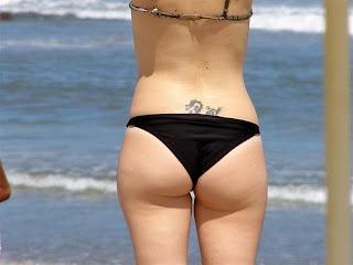 Tattoos femininas nas costas em volta