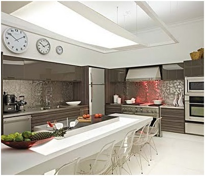 MODERN SILVER KITCHEN WITH ISLAND AND WHITE TABLE