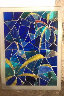 The framed and completed stained glass art