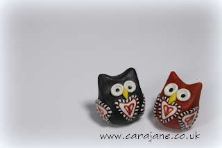 polymer clay owls decorated with hearts