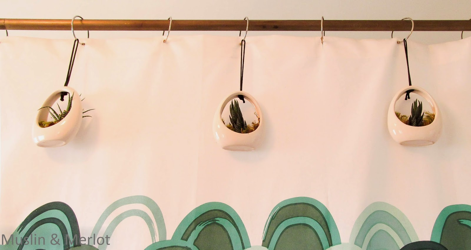 Hang tiny plants from your curtain rod rings!