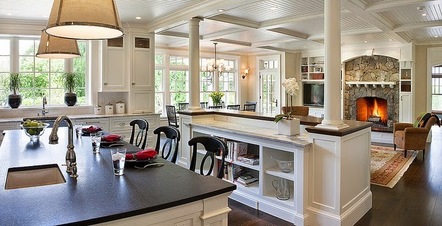 traditional beautiful white kitchen with dark hardwood floors black soapstone counter pendant lights