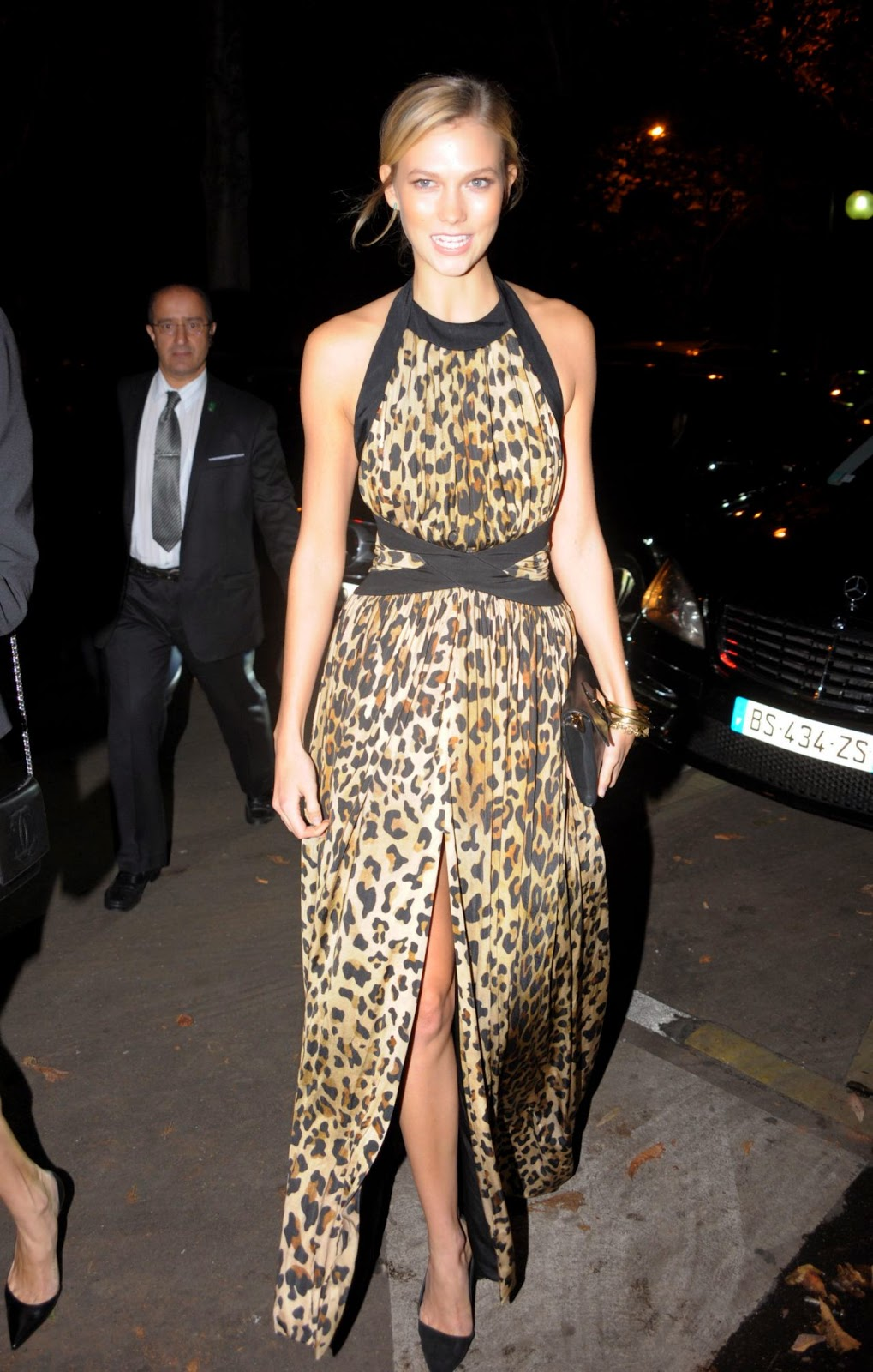 Karlie Kloss is elegant in a leopard print dress out and about in Paris