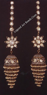 Earrings - This lush display seems to show, in black, white and gold, control over form and exquisite setting.