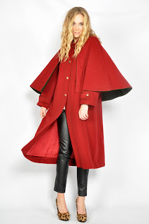 Vintage 1970's maxi length red military cape coat with green lining.