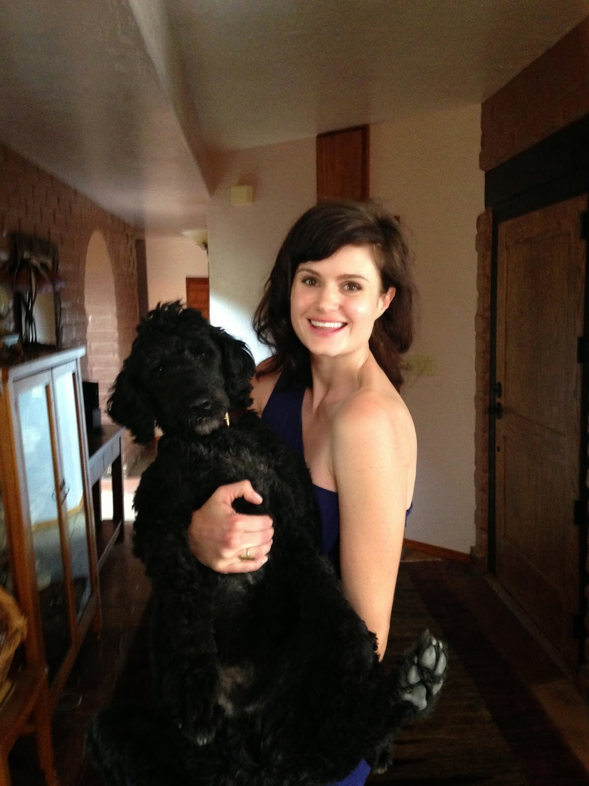Studio mascot, Cody the dog with his owner Johanna over Easter