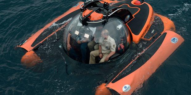 Russia's President Vladimir Putin channels his inner Bond villain into Black Sea to explore an ancient shipwreck off Crimea