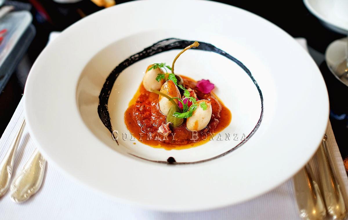 Sauteed calamari stuffed with chicory, sun dried tomato pesto