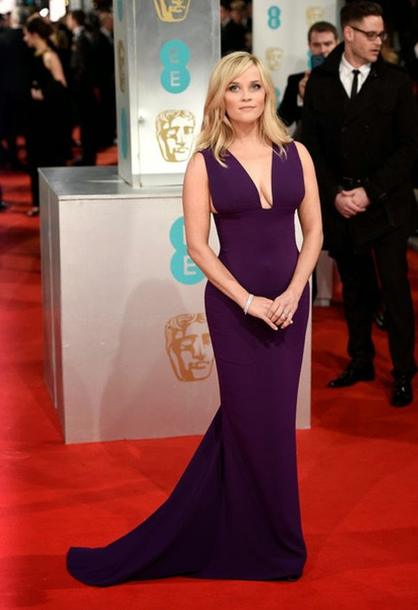 The floor-length purple gown by Stella McCartney showed off the 38-year-old's incredible figure to perfection on the 2015 EE British Academy Film Awards (BAFTA) at London, England on Sunday February 8, 2015