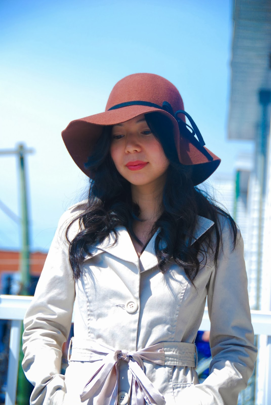 brown floppy hat trench coat