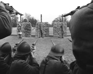 firing squad in paths of glory, directed by stanley kubrick