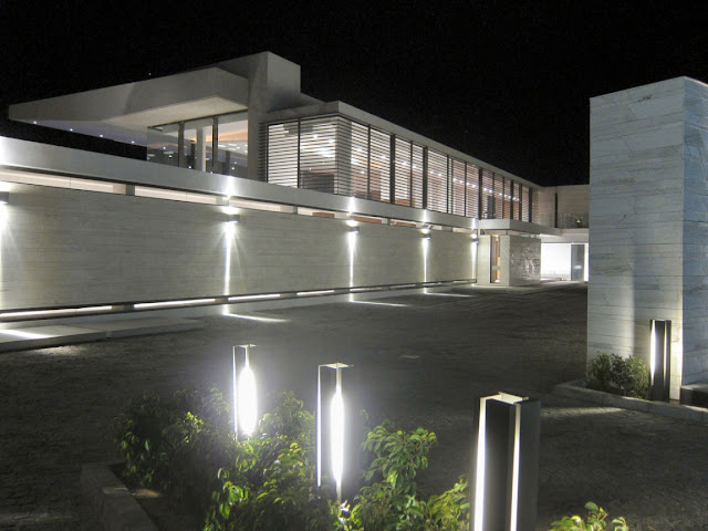 Picture of the driveway at night with lovely house ligtning