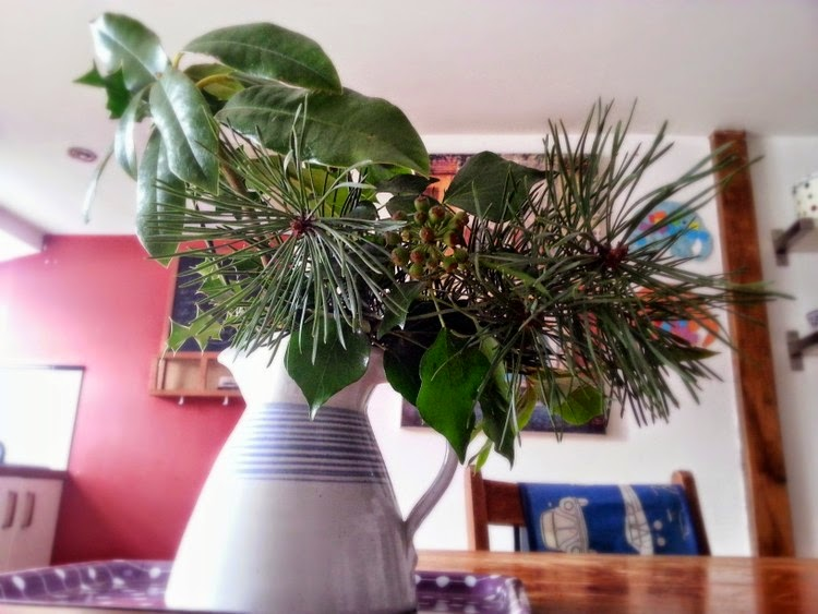 Bringing nature in: evergreen sprigs displayed in a vase