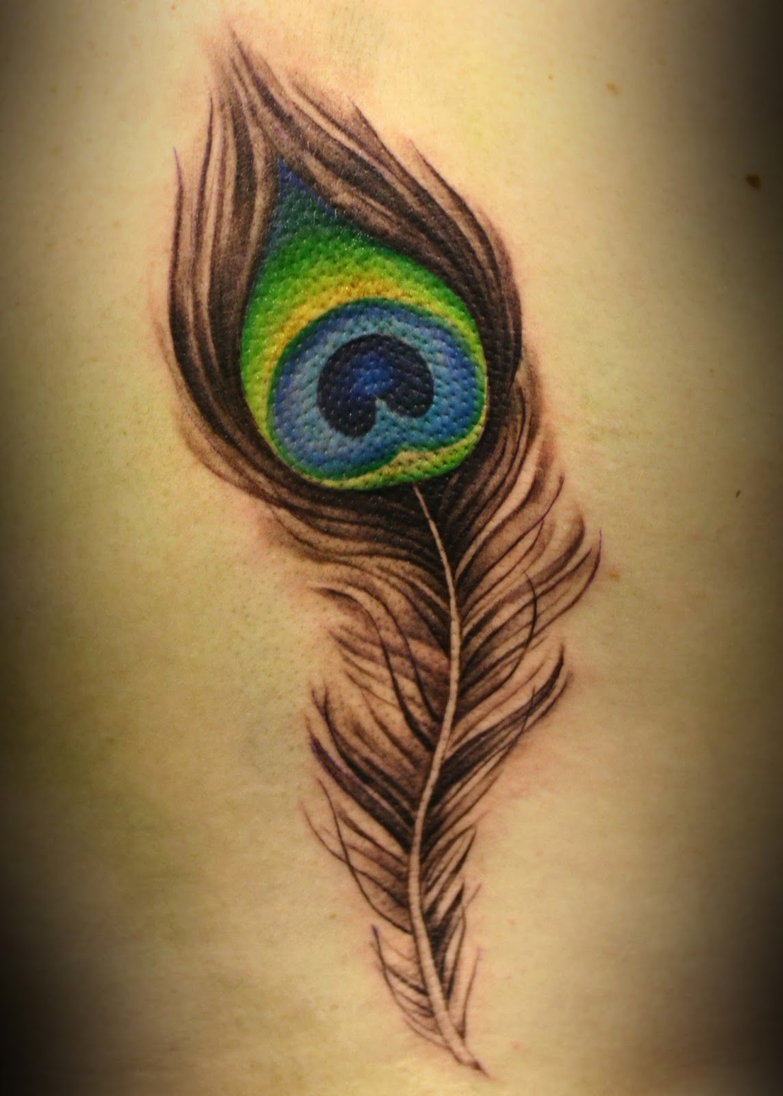 Colorful Feather Tattoo Tumblr Peacock feather tattoos
