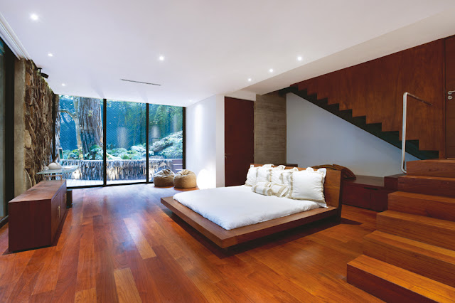 Picture of large modern bedroom with white bed and wooden floors