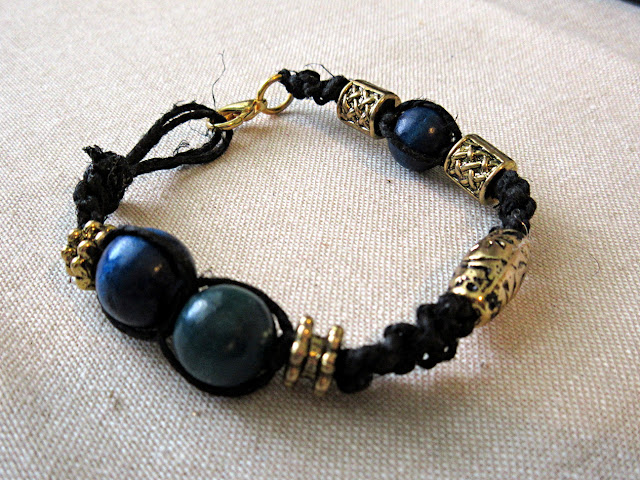 A black and gold woven hemp pi bracelet. Math jewelry is a unique gift for graduation, birthdays, or teachers!