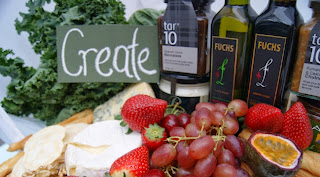 selection of fresh produce including kale and olive oil for Xmas
