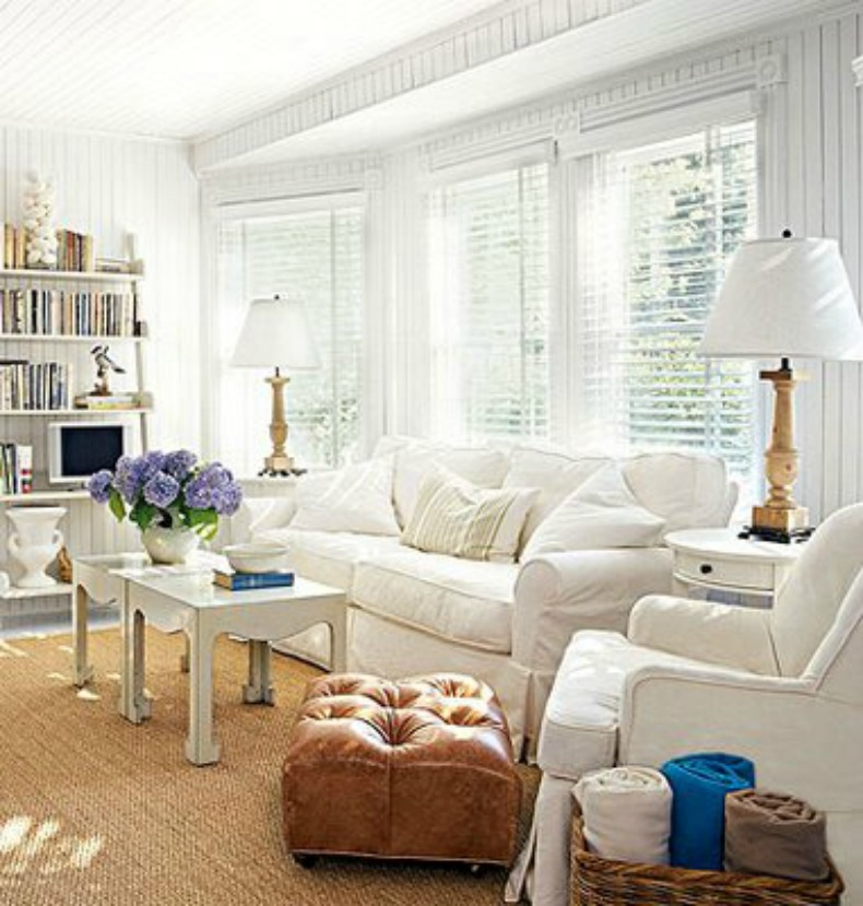 Coastal white slipcover sofa and chairs in a white on white room