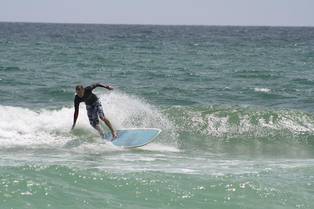Josh Harding Surfing at Pensacola Beach on Sunday May 13, 2012 throwing spray
