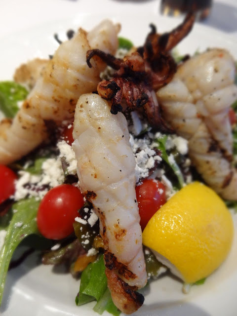 Grilled Calamari Salad with baby greens, roasted bell peppers, olives,