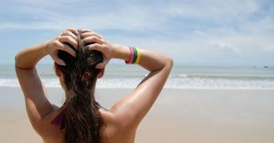 olio per capelli, applicazione olio solare protettivo per capelli, capelli sani e forti