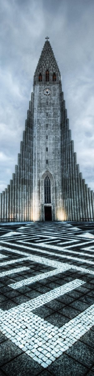 The Hallgrímskirkja is a Lutheran (Church of Iceland) parish church in Reykjavík, Iceland. At 74.5 metres (244 ft), it is the largest church in Iceland and the sixth tallest architectural structure in Iceland after Longwave radio mast Hellissandur, the radio masts of US Navy at Grindavík, Eiðar longwave transmitter and Smáratorg tower. The church is named after the Icelandic poet and clergyman Hallgrímur Pétursson (1614 to 1674), author of the Passion Hymns.  State Architect Guðjón Samúelsson's design of the church was commissioned in 1937. He is said to have designed it to resemble the basalt lava flows of Iceland's landscape. It took 38 years to build the church. Construction work began in 1945 and ended in 1986, the landmark tower being completed long before the church's actual completion. The crypt beneath the choir was consecrated in 1948, the steeple and wings were completed in 1974, and the nave was consecrated in 1986. Situated in the centre of Reykjavík, it is one of the city's best-known landmarks and is visible throughout the city. It is similar in style to the expressionist architecture of Grundtvig's Church of Copenhagen, Denmark, completed in 1940.  The church houses a large pipe organ by the German organ builder Johannes Klais of Bonn. It has mechanical action, four manuals and pedal, 102 ranks, 72 stops and 5275 pipes. It is 15 metres tall and weighs 25 tons. Its construction was finished in December 1992. It has been recorded by Christopher Herrick in his Organ Fireworks VII CD.