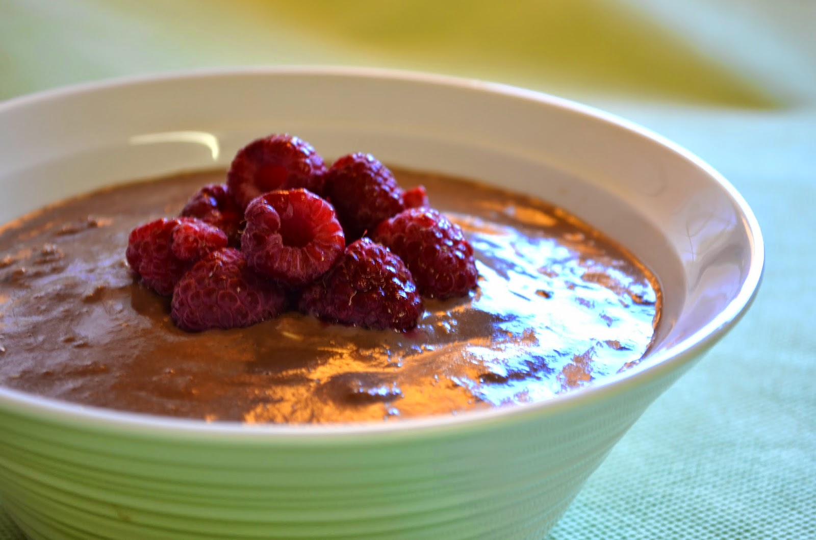 Chocolate porridge topped with raspberries