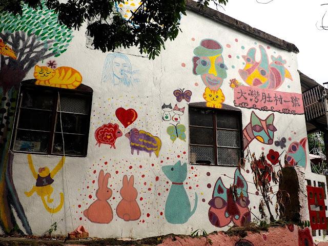 Animal mural on a building near Yung Shue Wan, Lamma Island, Hong Kong