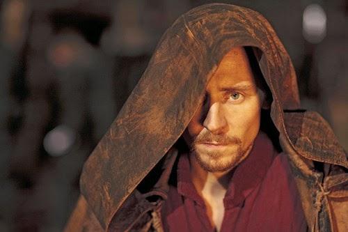Tom Hiddleston hiding under a cloak.