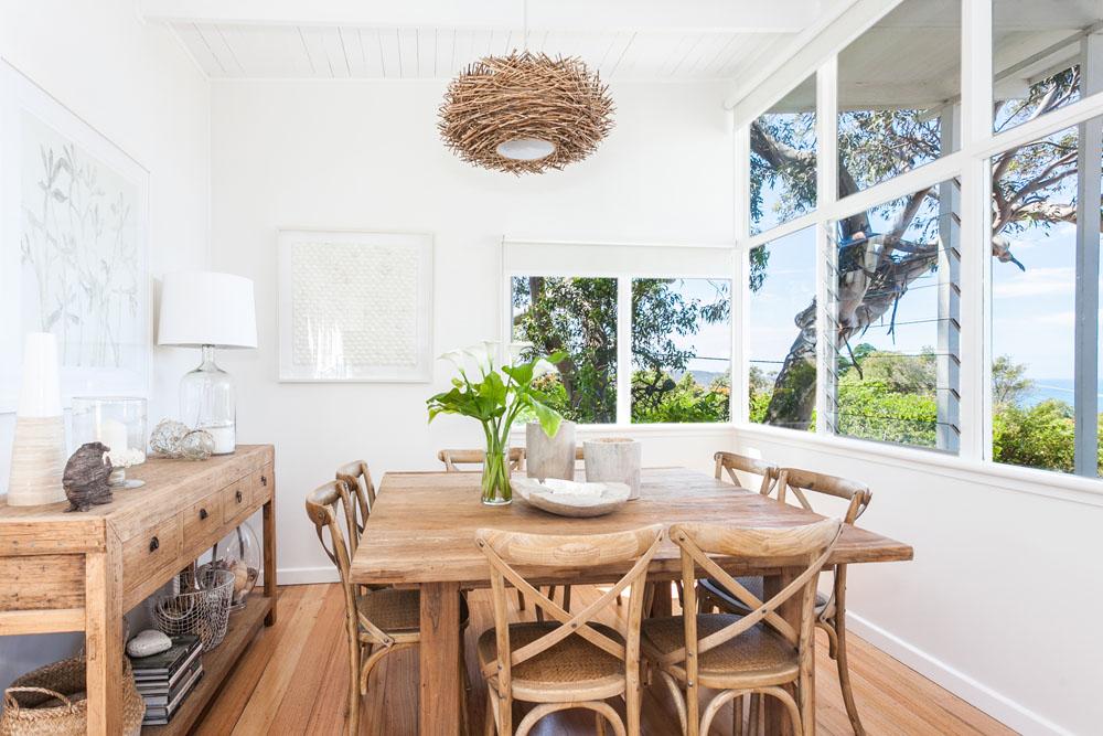 Coastal Dining Chairs. Framed Photos Of Beach Scenes Set The Tone ...