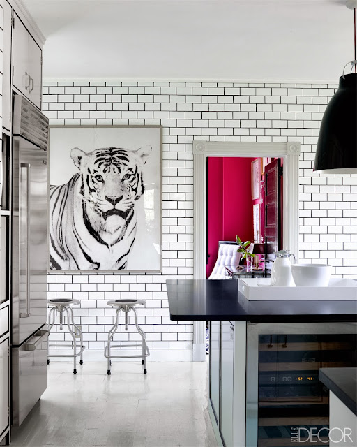 Black and white kitchen in Oscar PR Girl's weekend home