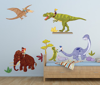 belle and Boo Dino Ride Wall Sticker Decal. Shown on a bedroom wall.