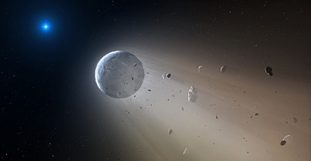 In this artist's conception, a tiny rocky object vaporizes as it orbits a white dwarf star. Astronomers have detected the first planetary object transiting a white dwarf using data from the K2 mission. Slowly the object will disintegrate, leaving a dusting of metals on the surface of the star. Credits: CfA/Mark A. Garlick
