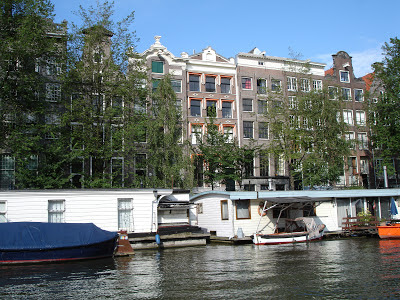 Amsterdam canal and boat houses