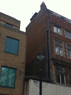 Ghost sign on the side of a building in Lower Marsh, London SE1