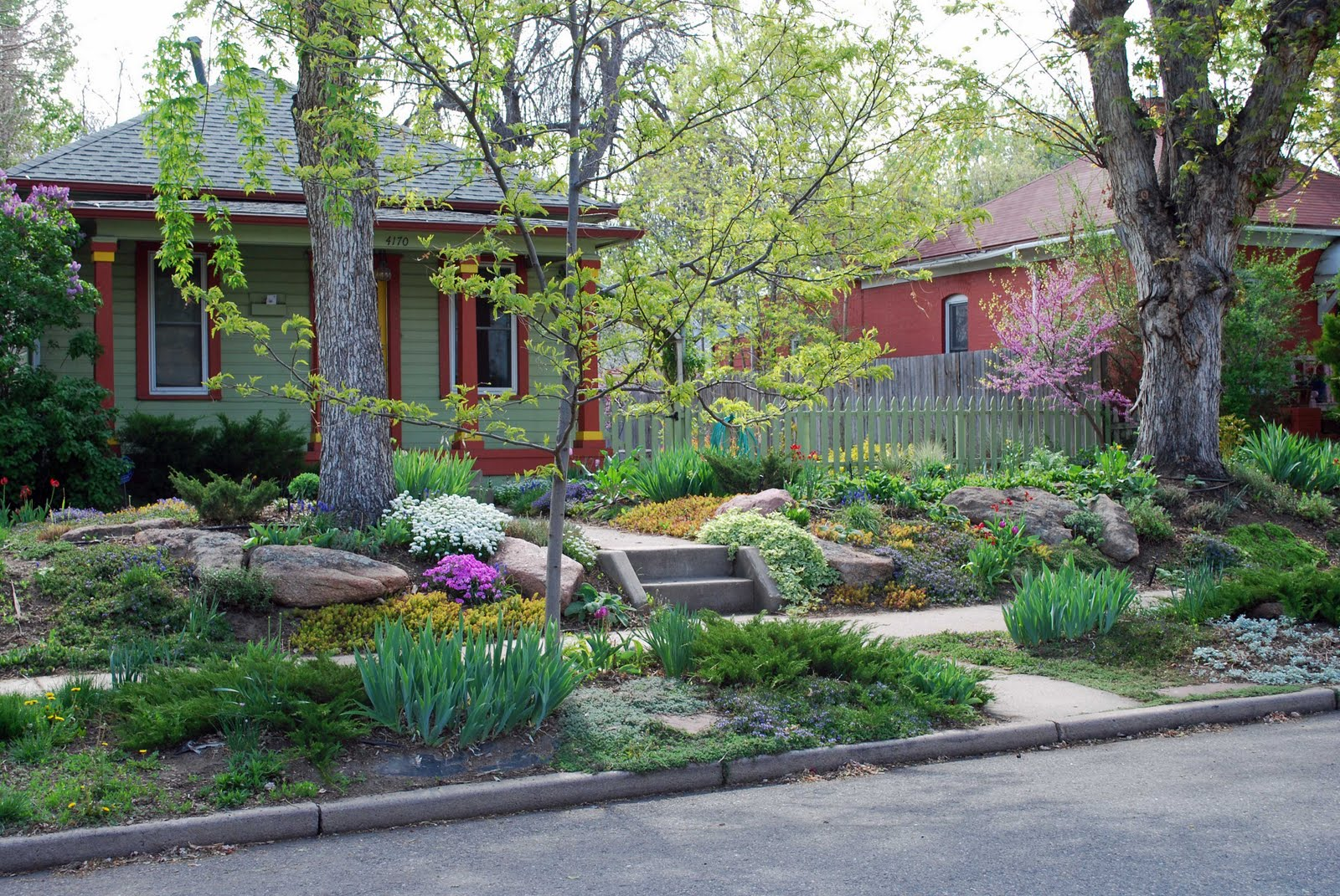 Big boulders for structure and a succession of colorful plantings for ...