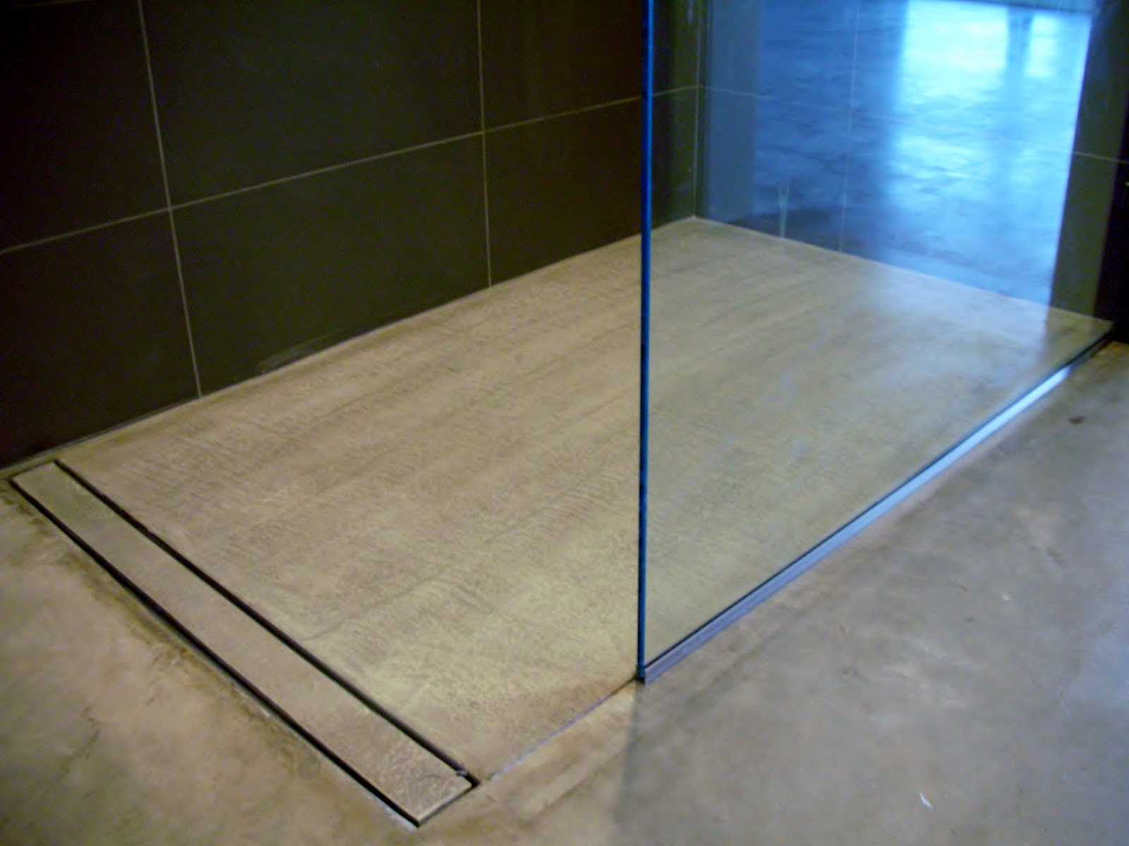 Bathroom Floor Drain : Mode concrete modern open concept bathroom featuring a