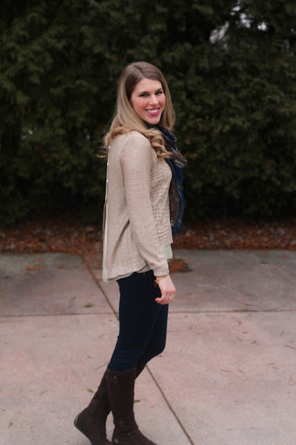 open back gold sweater with navy floral scarf, dark skinny jeans and brown riding boots