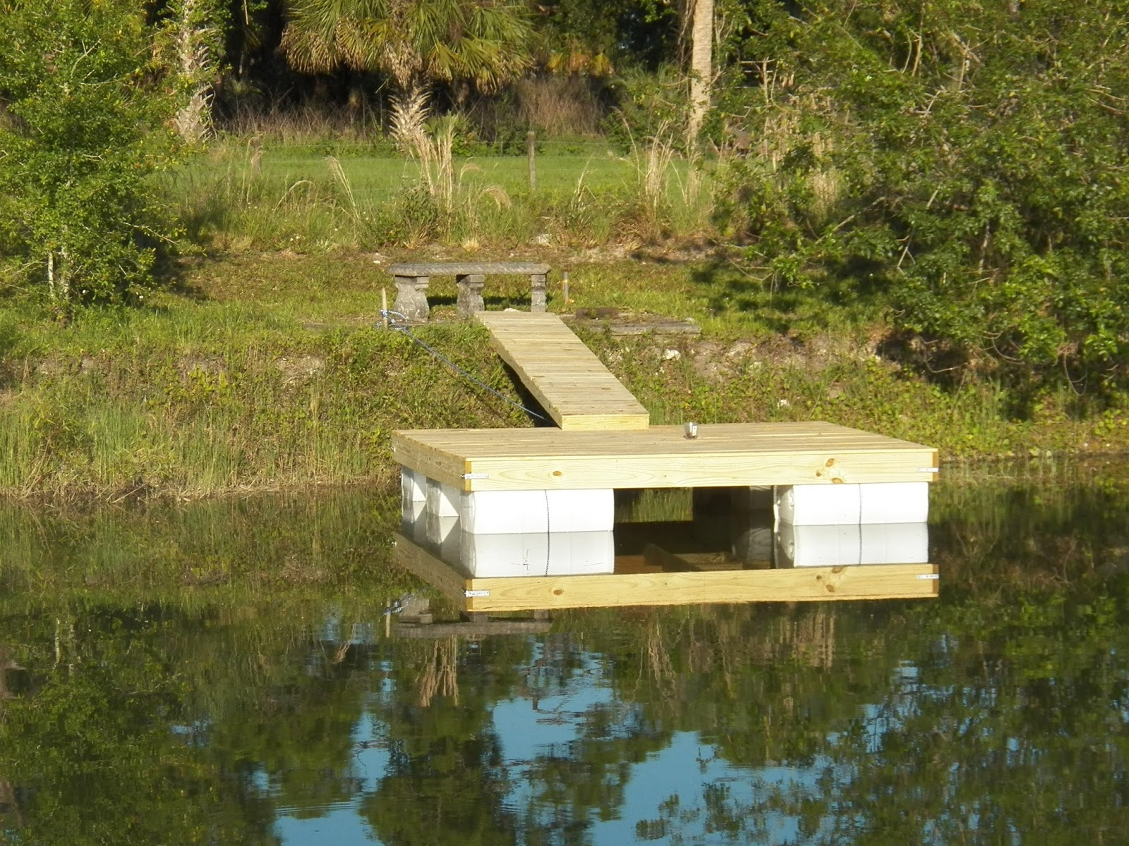 My backyard we built our own floating dock for Pond pier plans